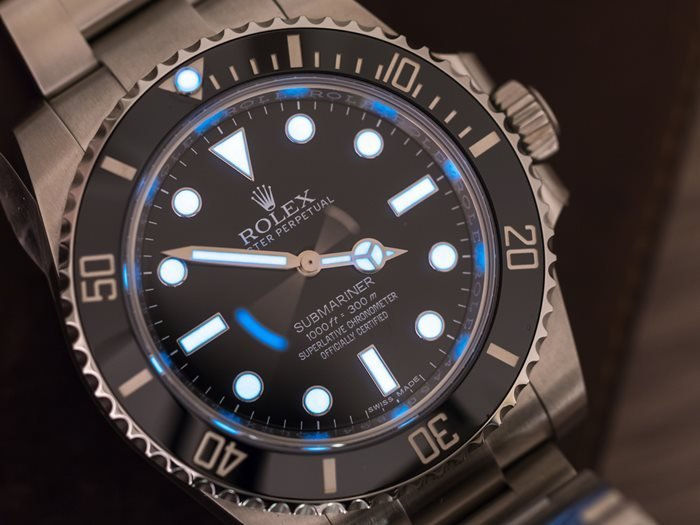Close up on the no-date Rolex Submariner with lume