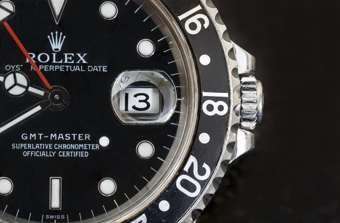 Rolex GMT Master Watch Close-up with Cyclop Lens
