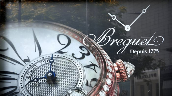 Breguet sign display on wall in center of Kuala Lumpur.