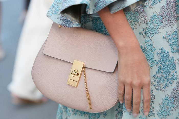 Woman with pink leather Chloe bag at Milan Fashion Show in 2017