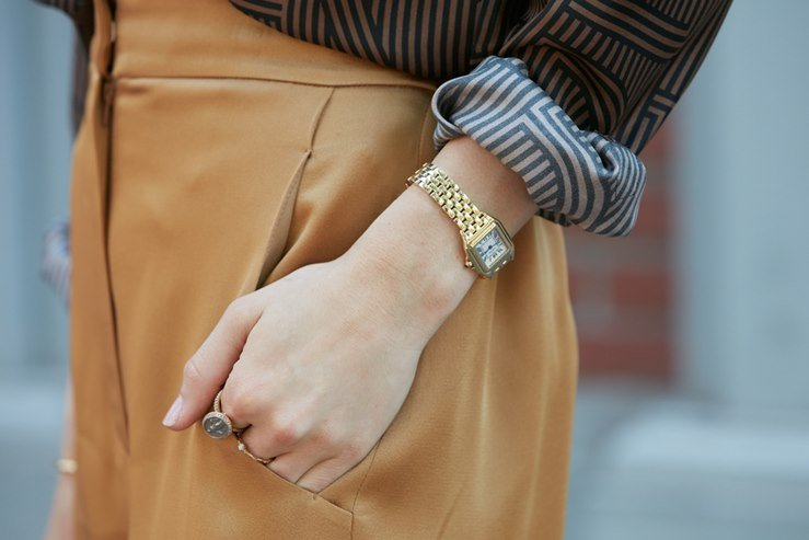 Woman spotted wearinga a golden Cartier Santos Watch before Fendi fashion show in Milan.