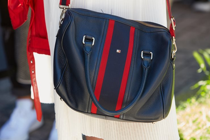 Tommy Hilfiger bag spotted before Etro fashion show in Milan, Italy.