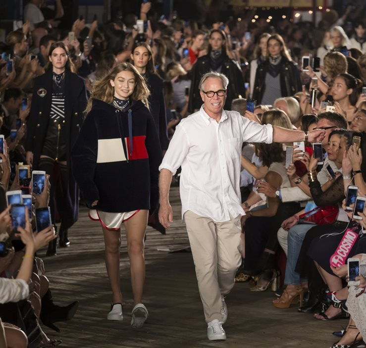 Gigi Hadid and designer Tommy Hilfiger walk the runway at Tommy Hilfiger Women's Fashion Show in New York.