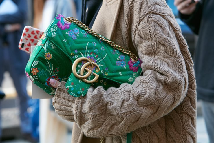 Gucci bag with floral design spotted before Max Mara fashion show in 2017. Milan, Italy.