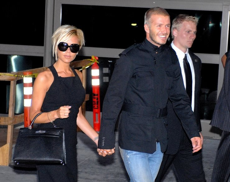 Victoria Beckham carrying an Hermes Kelly bag with her Husband David Beckham at LAX Airport, Los Angeles in 2007.