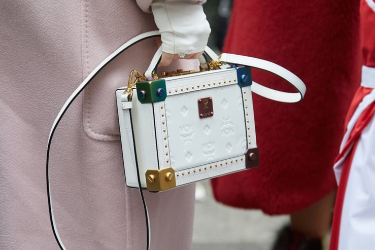White leather MCM bag spotted before Max Mara fashion show During Milan Fashion Week.