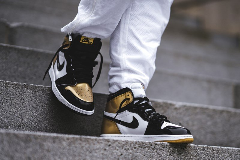 sports shoes 3508a c99a5 Air Jordan 1 Top 3 Gold Sneakers Review