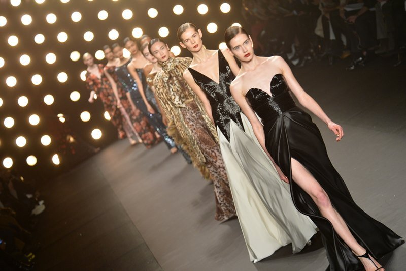 Models walk the runway at Naeem Khan Fall 2014 Collection during Mercedes-Benz Fashion Week